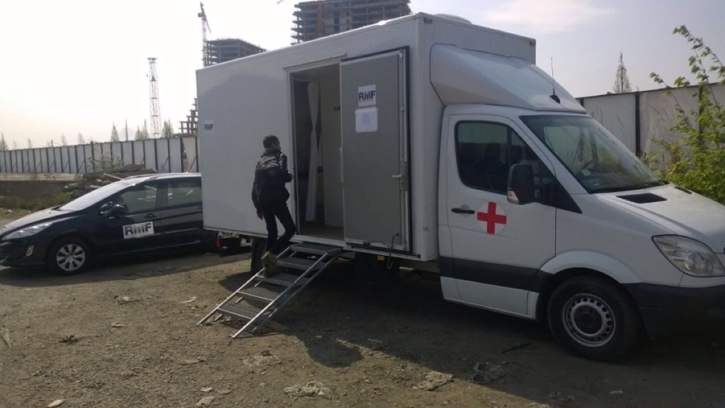 "RMF Serbia's mobile medical clinic near ""the Barracks"""