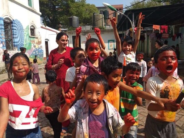 children celebrating Holi with decorative faces