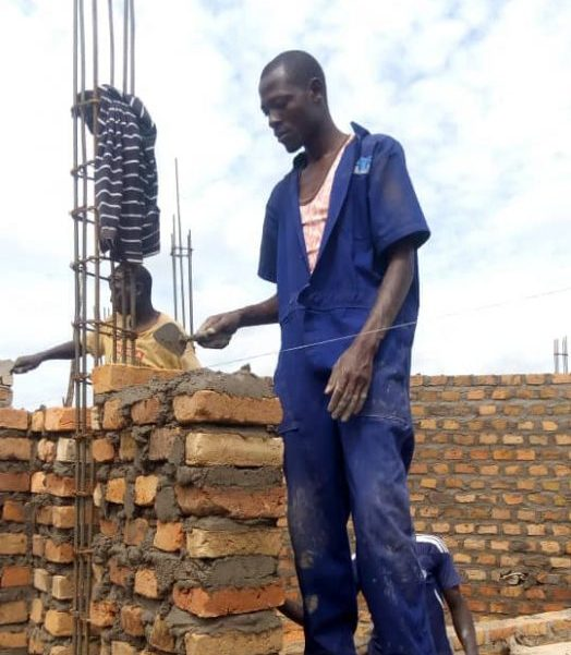 Abel Wasiwa employing the bricklaying skills he gained during his training at PVTI