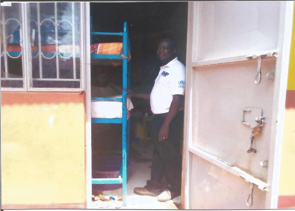 RMF Country Director Charles Lwanga at the dormitories of Precious Children's Center
