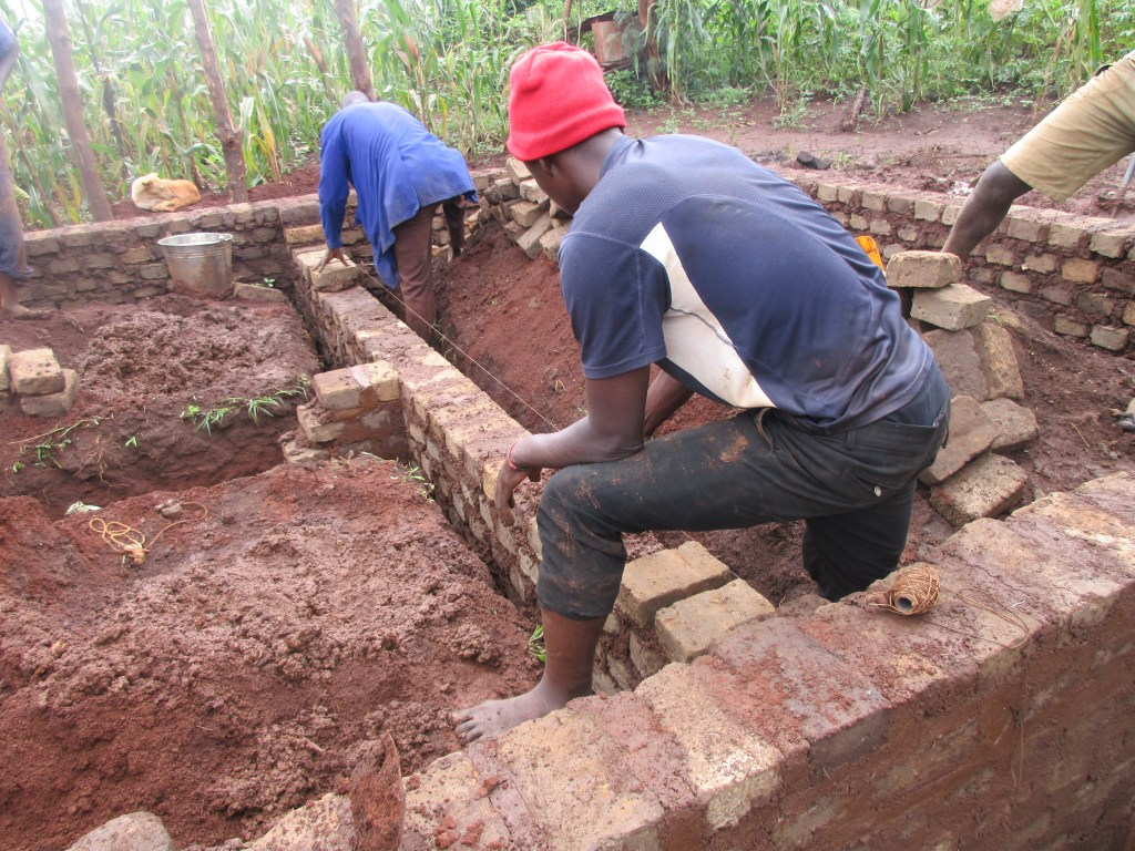 Bashir (in the blue overcoat) doing construction at the site.