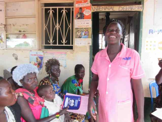 A midwife provides antenatal education to patients