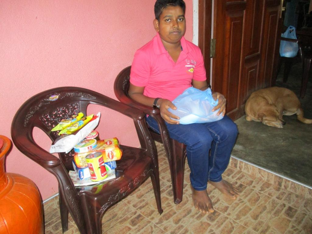 Gayan with his food parcel