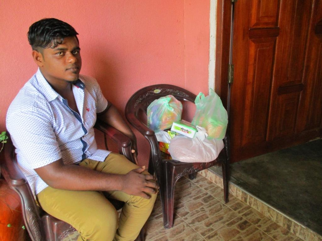Tharindu with his food parcel