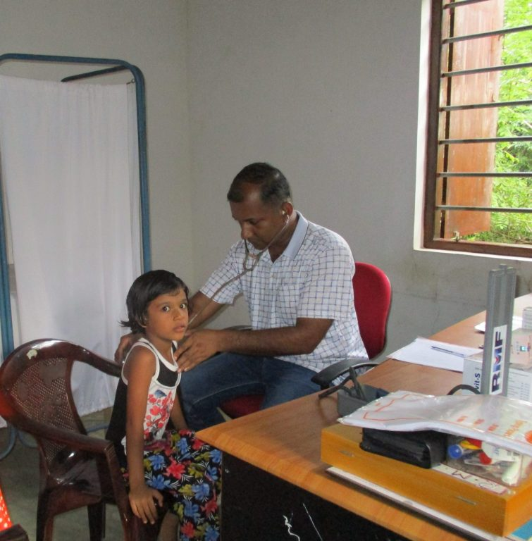 RMF Doctor Assessing a Child