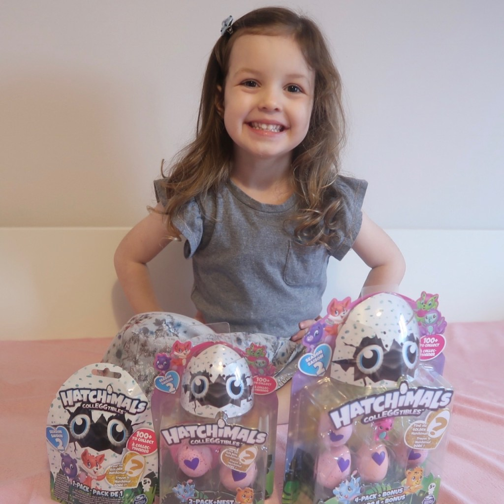 Girl with selection of Hatchimals CollEGGtibles Season 2
