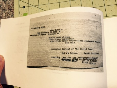 picture of original typed toilet paper from the group show, included in the book