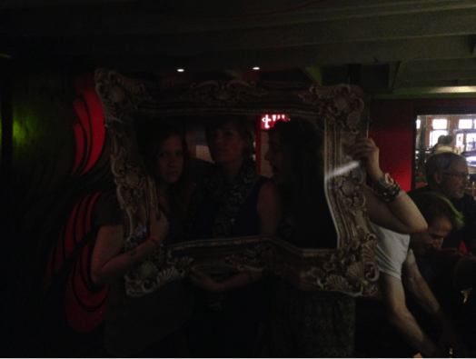 DC Poet folk (Michelle Dove, K. Lorraine Graham, and Meg Ronan) having fun with Meg Ronan's photo props, with Ryan Walker and Rod Smith to the right of the frame.