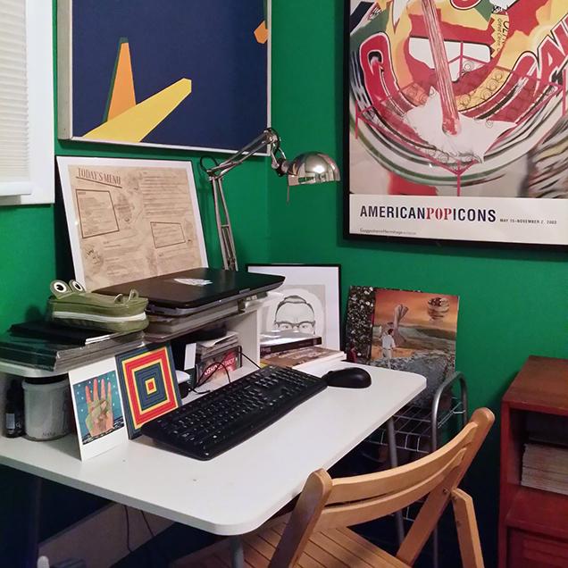 A photograph of the desk of Adam Tedesco