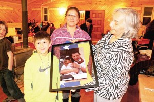 a-janie-with-chavez-and-son-and-picture-and-woman