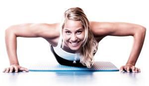 Women smiling while doing pushups