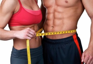 Fitness couple with measuring tape around them