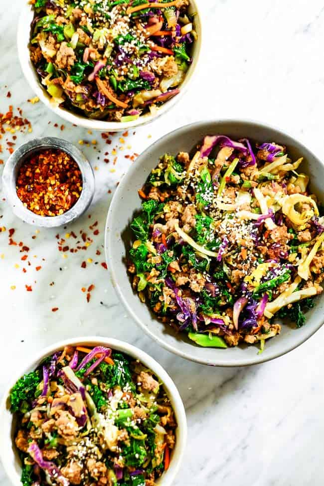 Egg roll in a bowl in three bowls. Made with cruciferous veggies, ground pork and a savory sauce.