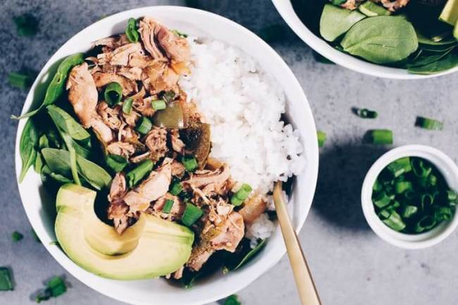 For this southwest chicken and rice, we've used a base of greens (just whatever greens you love and have on hand), white or cauliflower rice and the chicken mixture with some extra saucy goodness spooned on top. We added some healthy fats with a little avocado and sprinkled chopped green onion on there. #paleo #whole30 #instantpot | realsimplegood.com