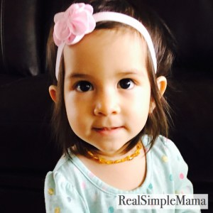 Tiny in Baltic Secret amber teething necklace - real simple mama