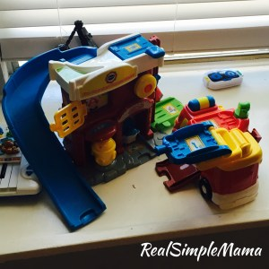 What's In Our Playroom? Fall 2017 Edition - Real Simple Mama image v tech go go smart wheels firetruck station rescue
