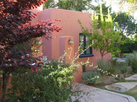 Architecture becomes a beautiful backdrop to the lush landscaping at the Arizona Inn