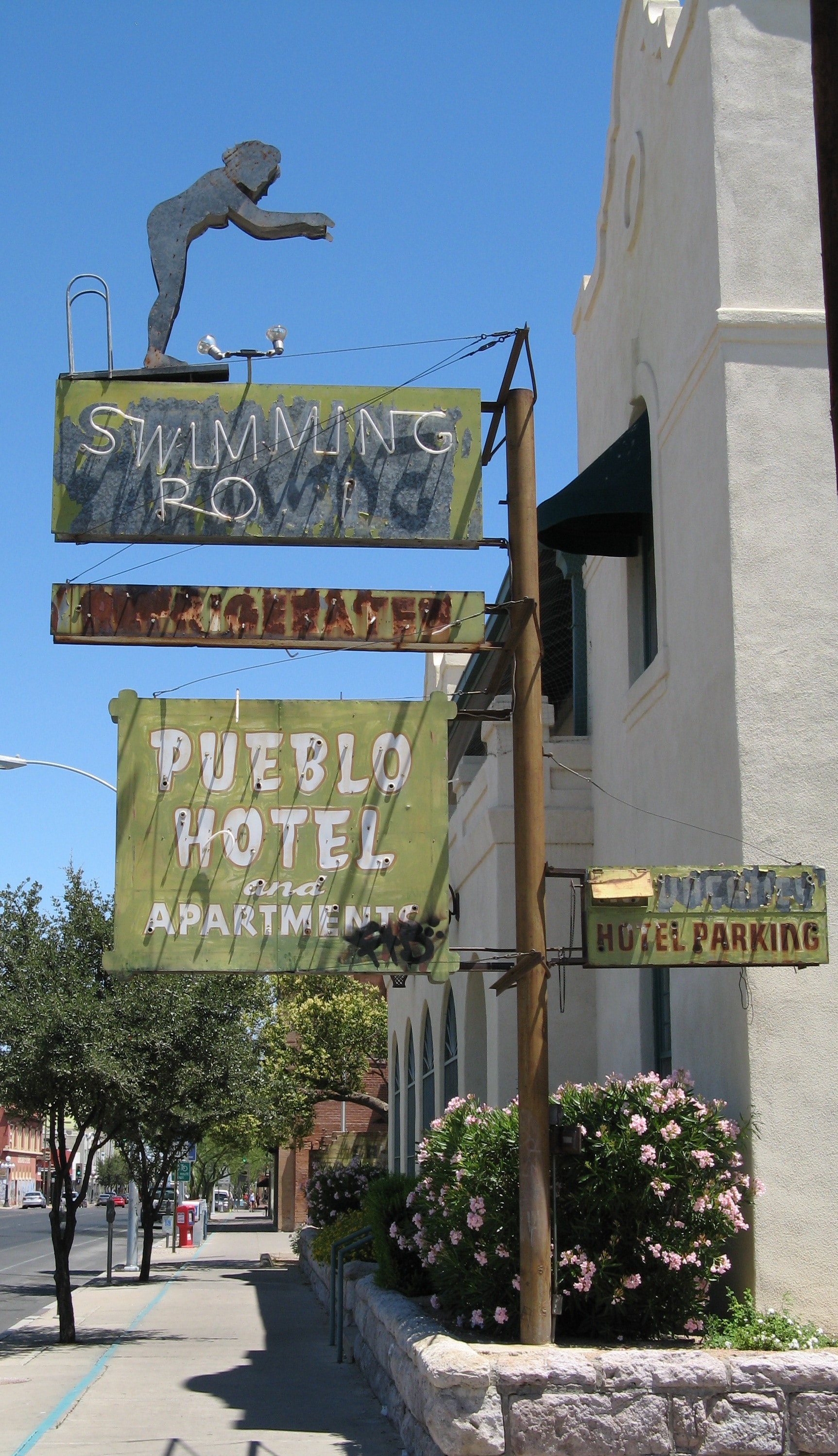 Pueblo Hotel neon sign with the classic diving lady. Tucson, Arizona.