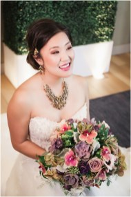 Gown from The Bridal Box; Headpiece by Always Elegant Bridal & Tuxedo; Earrings by Sorelli; Necklace from Macy's; Bouquet by Strelitzia Flower Company; Hair by Halo Salon & Day Spa; Makeup by Happily Beautiful Makeup Artistry & Skin Studio; Photography by 2 Girls 20 Cameras on location at Kimpton Sawyer Hotel.