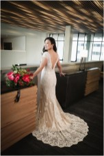 Gown from The Clothes Mine; Necklace from Macy's; Earrings by Style Avenue Studios; Bouquet by Paradise Parkway Event Productions; Hair by Halo Salon & Day Spa; Makeup by Happily Beautiful Makeup Artistry & Skin Studio; Photography by 2 Girls 20 Cameras on location at Kimpton Sawyer Hotel.