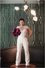 Pantsuit from Second Summer Bride; Earrings by Chloe + Isabel; Shoes by DSW; Bouquet by Morningside Florist; Hair by Halo Salon & Day Spa; Makeup by Happily Beautiful Makeup Artistry & Skin Studio; Photography by 2 Girls 20 Cameras on location at Kimpton Sawyer Hotel.