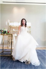 Gown by Valeri Bridal from Diamond Bridal Gallery; Jewelry by Mariell; Bouquet by Placerville Flowers on Main; Hair by Halo Salon & Day Spa; Makeup by Happily Beautiful Makeup Artistry & Skin Studio; Photography by 2 Girls 20 Cameras on location at Kimpton Sawyer Hotel.