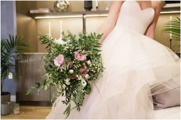 Gown from Always Elegant Bridal & Tuxedo; Headpiece by Mariell; Earrings by Chloe + Isabel; Bouquet by Wild Flowers Design Group; Hair and makeup by All Dolled Up Hair and Makeup Artistry; Photo by 2 Girls 20 Cameras, on location at Kimpton Sawyer Hotel