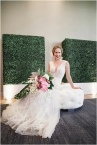 Gown by Luce Sposa from Diamond Bridal Gallery; Headpiece and earrings by Twigs & Honey; Bouquet by Wild Flowers Design Group; Hair and makeup by All Dolled Up Hair and Makeup Artistry; Photo by 2 Girls 20 Cameras, on location at Kimpton Sawyer Hotel