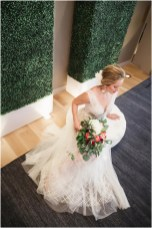 Gown by Luce Sposa from Diamond Bridal Gallery; Headpiece and earrings by Twigs & Honey; Bouquet by Accents by Sage Floral Design; Hair and makeup by All Dolled Up Hair and Makeup Artistry; Photo by 2 Girls 20 Cameras, on location at Kimpton Sawyer Hotel