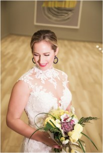 Gown from De la Rosa's Bridal & Tuxedo; Earrings from Macy's; Bouquet by Bloem Decor; Hair and makeup by All Dolled Up Hair and Makeup Artistry; Photo by 2 Girls 20 Cameras, on location at Kimpton Sawyer Hotel