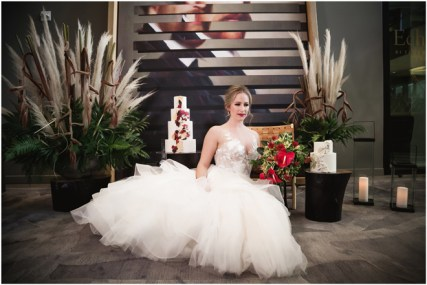 Gown from Always Elegant Bridal & Tuxedo; Headpiece by Always Elegant Bridal & Tuxedo; Earrings by Sorrelli Jewelry; Bouquet by Paradise Parkway Event Productions; Hair and makeup by All Dolled Up Hair and Makeup Artistry; Photo by 2 Girls 20 Cameras, on location at Kimpton Sawyer Hotel