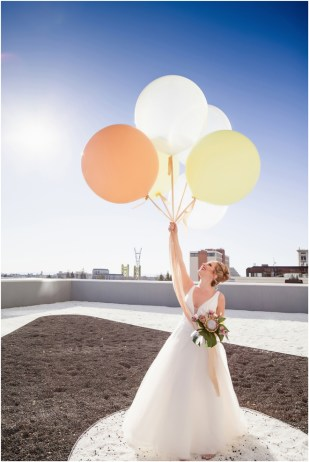 Gown from The Bridal Box; Earrings by Luxurious Bridal; Bouquet by Hillside Blooms Floristry; Hair and makeup by All Dolled Up Hair and Makeup Artistry; Photo by 2 Girls 20 Cameras, on location at Kimpton Sawyer Hotel. Balloons by The Party Concierge