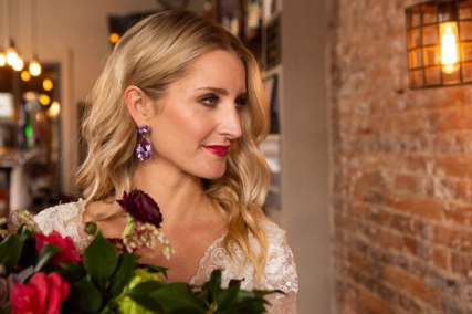 Gown by Solo Merav from Diamond Bridal Gallery; Earrings by Mariell; Bouquet by Placerville Flowers on Main; Hair by Lisa Harter Hair and Makeup Artist; Makeup by Happily Beautiful Makeup Artistry & Skin Studio. Photography by Farrell Photography on location at Hotel Sutter.