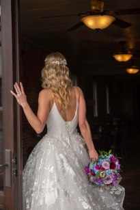 Gown from The Clothes Mine; Headpiece by Always Elegant Bridal & Tuxedo; Earrings from Macy's; Bouquet by Strelitzia Flower Company; Hair by Lisa Harter Hair and Makeup Artist; Makeup by Happily Beautiful Makeup Artistry & Skin Studio. Photography by Farrell Photography on location at Hotel Sutter.