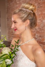 Gown from The Bridal Box; Headpiece and earrings by USABride; Bracelet from Macy's; Bouquet by The Party Concierge; Hair by Lisa Harter Hair and Makeup Artist; Makeup by Happily Beautiful Makeup Artistry & Skin Studio. Photography by Farrell Photography on location at Hotel Sutter.