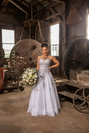 Gown from My Martha Design Boutique; Earrings and necklace by Sorrelli Jewelry; Bracelet by Chloe + Isabel; Bouquet by Relles Florist; Hair and makeup by All Dolled Up Hair and Makeup Artistry; Photography by Farrell Photography on location at Hotel Sutter.