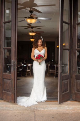 Gown from The Clothes Mine; Headpiece and earrings by USABride; Bouquet by Carson Valley Florist; Hair and makeup by All Dolled Up Hair and Makeup Artistry; Photography by Farrell Photography on location at Hotel Sutter.