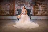Gown by Valeri Bridal from Diamond Bridal Gallery; Earrings from Macy's; Bouquet by Rodarte Floral Design; Hair and makeup by All Dolled Up Hair and Makeup Artistry; Photography by Farrell Photography on location at Hotel Sutter.