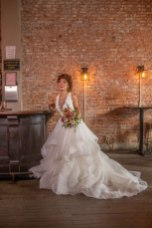 Gown from Diamond Bridal Gallery; Jewelry from Macy's; Bouquet by Amour Florist & Bridal; Hair and makeup by All Dolled Up Hair and Makeup Artistry; Photography by Farrell Photography on location at Hotel Sutter.