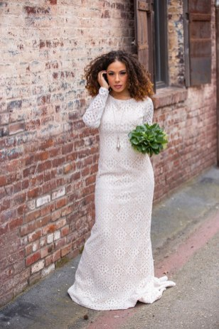 Gown from Always Elegant Bridal & Tuxedo; Earrings by Macy's; Boots by Ariat; Bouquet by Carson Valley Florist; Hair and makeup by All Dolled Up Hair and Makeup Artistry; Photography by Farrell Photography on location at Hotel Sutter.