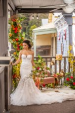 Gown by Solo Merav from Diamond Bridal Gallery; Headpiece by Hair Comes the Bride; Jewelry by USABride; Bouquet by Flourish; Hair and makeup by All Dolled Up Hair and Makeup Artistry; Photography by Farrell Photography on location at Hotel Sutter.
