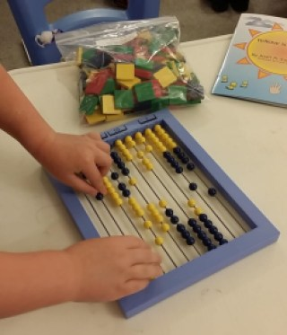 using the Right Start Curriculum -- N's first time using the abacus