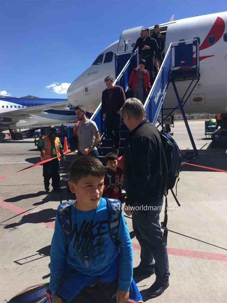 Peru with kids landing in Cusco
