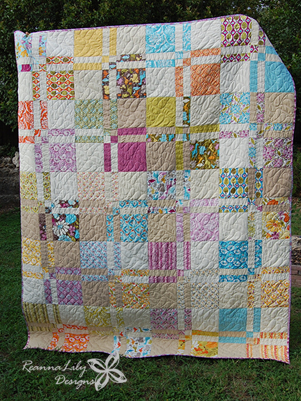Disappearing 4-Patch with Layer Cakes by Jen Eskridge | Queen Size Quilt | Free Pattern | ReannaLily Designs | ReannaLily Quilts