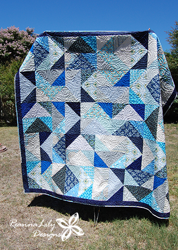 Fat Quarter Flying Geese Quilt | Jen Eskridge | ReannaLily Designs - made using blue fabric scraps