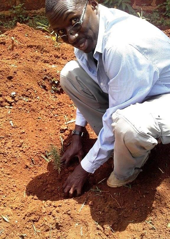 Photo of Rev John Mark Oduor planting during Easter Tree Planting