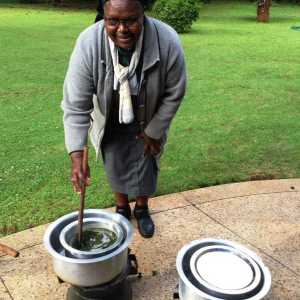 Sr Francisca stirs an ointment in water bath during seminar May 2018