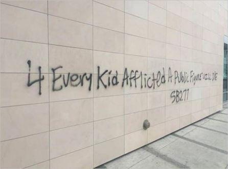 SB277 2 death threat graffiti