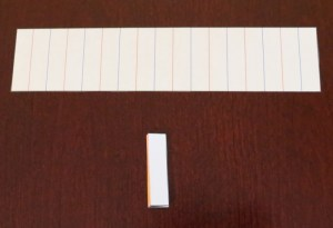 Accordion folded strip of paper