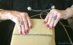 Her bejeweled fingers opened her stylish gold purse